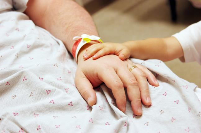 Hand with child iStock_000003422221Small